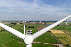 Siemens will install 13 more gearless wind turbines, such as the model SWT-3.0-113 unit shown here, at 2 projects in Lower Saxony and Schleswig-Holstein.