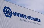 HUBER+SUHNER legt im Umsatz leicht zu und verbessert die Ertragslage deutlich