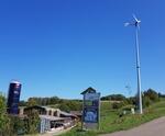 Auch in der Schweiz freut man sich über Windstrom