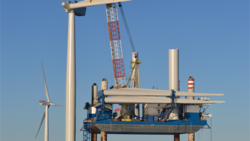 Sea Worker, a jack-up barge, installing the first blade on a turbine
