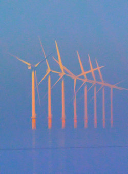 Off shore wind turbines bathed in mist and warm autumnal sunshine. The turbines are located on Burbo Bank about 4 miles offshore / Photo Credit: Creative Commons - Steve Fareham
