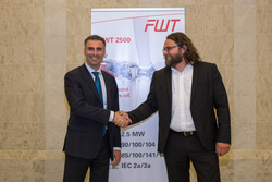 Mr. Sergo Mamaladze (Vice Chairman of FALKON CAPITAL a.s.,), left, and Mr. Bernd Gieseler (CEO of FWT Production GmbH), right, while sealing the signed agreement by handshake of partners