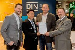 From left: Peter Vojcena, (SAERTEX GmbH & Co. KG); De-Won Cho (DIN e.V.); Max Altenähr (SAERTEX GmbH & Co. KG); Holger Wülfken (Citec Engineering und Information GmbH)
