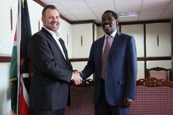 Windlab Africa MD Peter Venn and Meru County Governor Peter Munya sign the development agreement