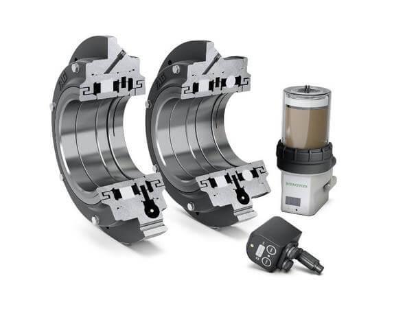 FAG Flanschlager-Gehäuseeinheiten FERS (link) und FERB (rechts) mit Service-Paket für Elektromotoren: Condition Monitoring System SmartCheck und Schmierstoffgeber Concept2 (Bild: Schaeffler)