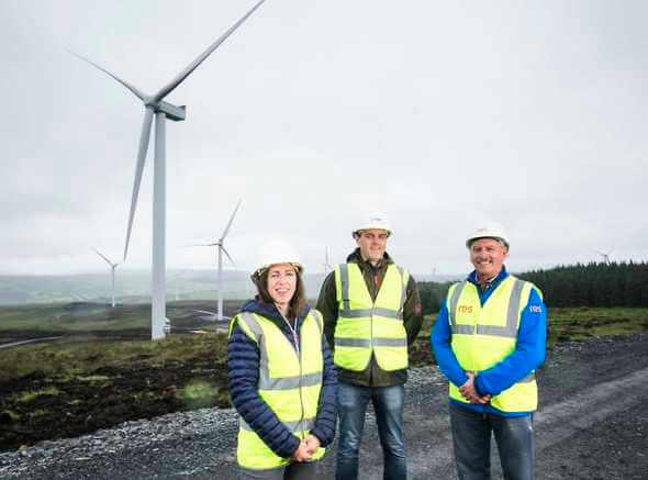Fionnuala Brennan, Relationship Manager at First Trust Bank is pictured with NTR Program Manager Martin Sweeney and Noel Breslin, Site Manager from RES at Castlecraig Wind Farm (Image: RES)