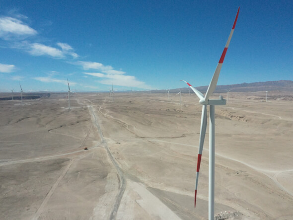 Tchamma turbines, above, and Mainstream team switch on transformer at Cerro Tigre wind farm last monh (Image: Mainstream Renewable Power)