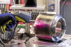 Scanning the data matrix code on a reconditioned axlebox bearing. The DMC ensures quick and easy access to important manufacturing, operating and maintenance data at all times (Image: Schaeffler)